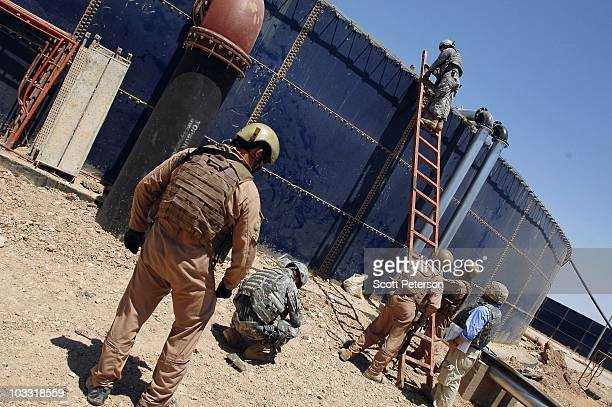 Officers of the US Army Corps of Engineers inspect the USfunded waste water treatment plant in Fallujah Iraq on July 23 2010 The USACE has spent $190...