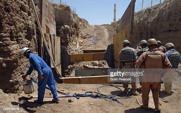 Officers of the US Army Corps of Engineers inspect trunk line excavations for a waste water project in Fallujah Iraq on July 23 2010 The USACE has...