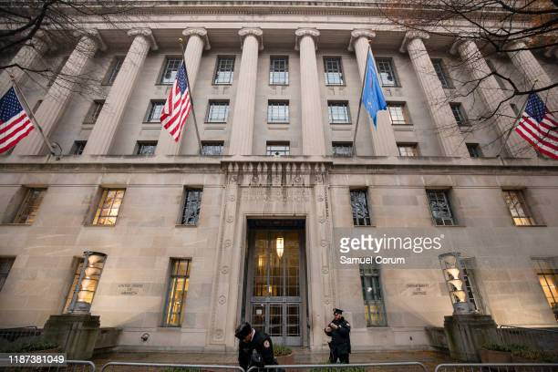 Officers open up an entrance to the Justice Department building on a foggy morning on December 9, 2019 in Washington, DC. It is expected that the...