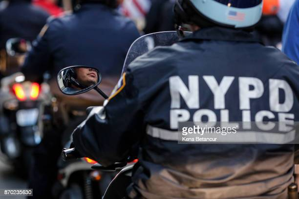 NYPD officers patrol during a nationwide protest against Trump Administration in Manhattan on November 4 2017 in New York City AntiTrump protests are...