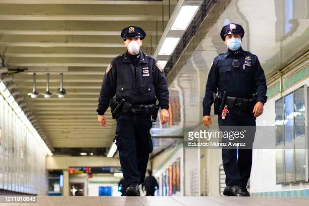 Officers patrol inside Times Square station as the New York City subway system, the largest public transportation system in the nation is set for...