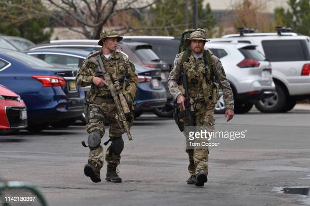 Officers patrol the scene of a shooting in which at least seven students were injured at the STEM School Highlands Ranch on May 7 2019 in Highlands...