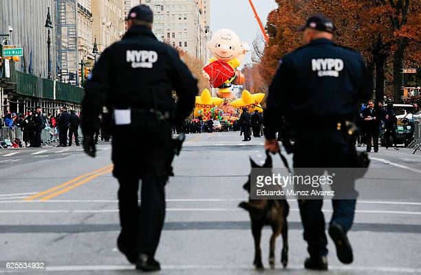 NYPD officers patrol the street as people arrive to watch the 90th Macy's Annual Thanksgiving Day Parade on November 24 2016 in New York City...