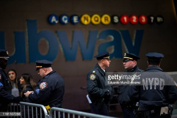 Officers patrol the subway station as people arrive to celebrate New Years Eve in Times Square on December 31, 2019 in New York City. Because of the...