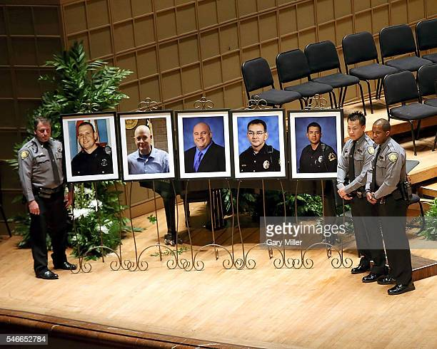 Officers pose with photos of the fallen Dallas Policemen Michael Krol Brent Thompson Lorne Ahrens Michael Smith and Patrick Zamarripa during the...