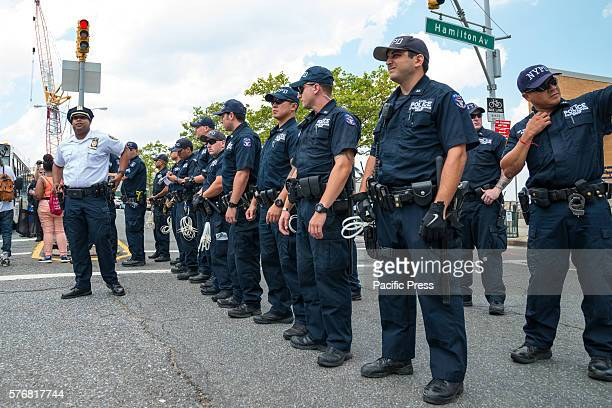 NYPD officers prepare to block the progress of the demonstrators on Richmond Terrace On the second anniversary of the death of Eric Garner during his...