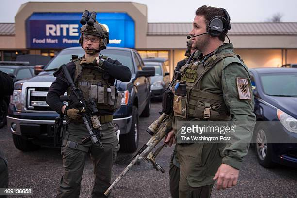Officers prepare to head toward the US Census Bureau building after reports that a federal officer had been shot at the US Census Bureau in Silver...