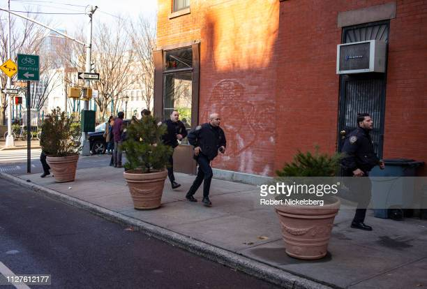 NYPD officers pursue the driver of a stolen vehicle that crashed on a street in the Cobble Hill neighborhood of Brooklyn New York on February 5 2019...