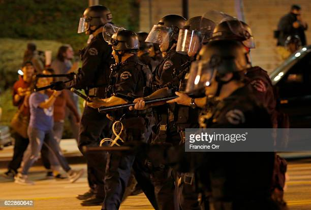 Officers react to a protestors throwing rocks at them outside Grand Park on Broadway in Los Angeles, CA November 11, 2016. The anti Trump...