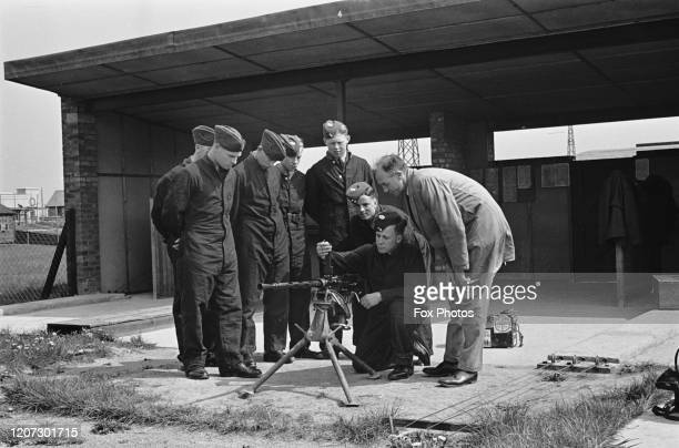 Officers receiving instruction on the M1919 Browning machine gun at the RAF Training School at RAF Manby near the village of Manby Lincolnshire...