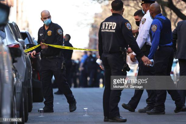 Officers respond to the scene of a shooting that left multiple people injured in the Flatbush neighborhood of the Brooklyn borough on April 06, 2021...