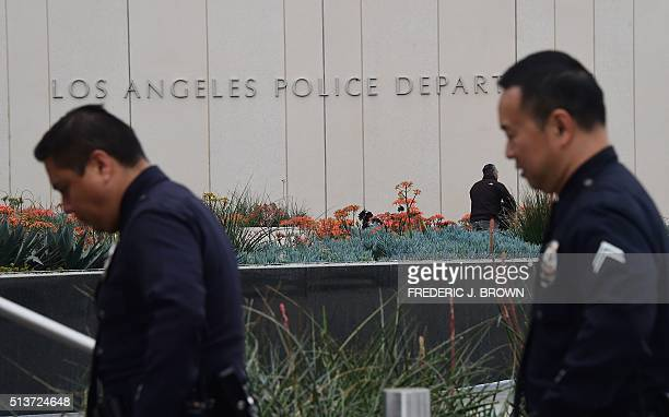 LAPD officers return to headquarters on March 4 folllowing a press conference where Los Angeles police announced an investigation into whether a...