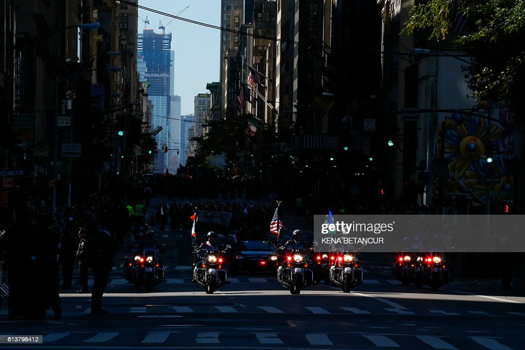 NYPD officers ride motorcycles as they attend the annual Columbus Day parade in New York on October 10, 2016. / AFP / KENA