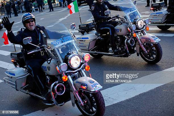 NYPD officers ride motorcycles as they attend the annual Columbus Day parade in New York on October 10 2016 / AFP / KENA BETANCUR