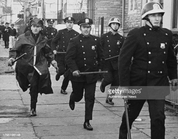 Officers running in to head off striking students during the series of protests on the campus of Columbia University in New York City, New York,...