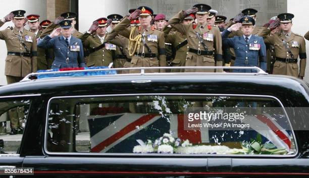 Officers salute the coffin of Major Sean Birchall of the 1st Battalion Welsh Guards following his funeral service at the Guards Chapel London