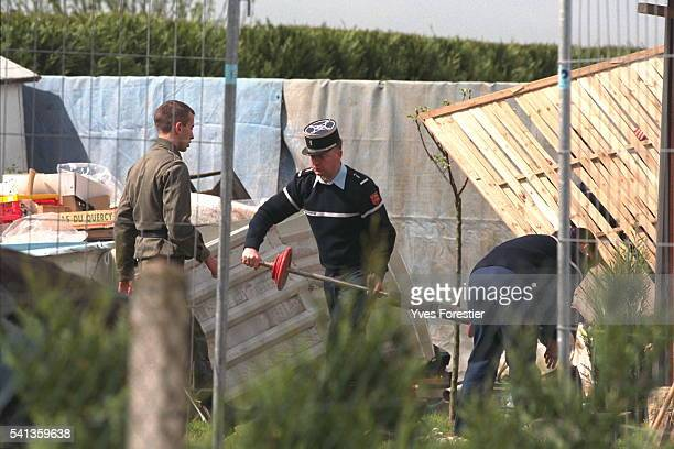 Officers search the spot in the garden where JeanYves Morel told them he buried Marylene Roussey