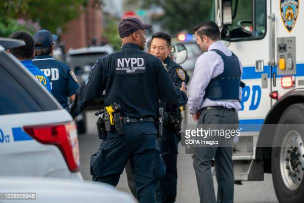 Officers seen on the shooting scene. Police from 109th Precinct, Queens responded to an altercation of a male and female at a residence in College...
