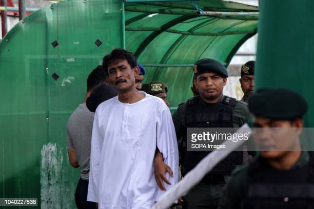 LHOKSEUMAWE ACEH INDONESIA Officers seen taking a convicted person to be flogged in public who was considered to violate the Islamic Sharia law...