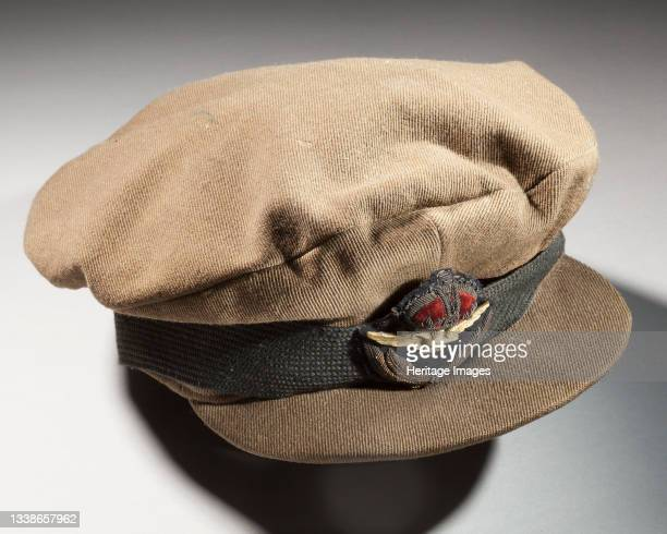 Officer's service cap, Royal Flying Corps, circa 1910s. First World War O.D. Billed cap with RFC badge and RAF cloth badge worn over band, owned by...