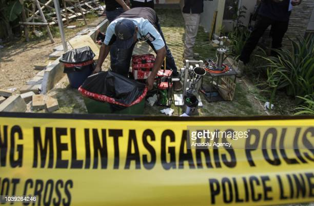 Officers show collected evidence in an operation on an ecstasy factory at Sentra Pondok Rajeg Housing, in Cibinong, Bogor, West Java, Indonesia on...