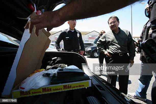 LAPD officers show pizza box full of narcotics to Raul Delgado owner of La Pizza Loca at 1306 S Gaffey in San Pedro as more than 1300 federal and...