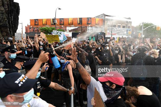Officers spray mace into the crowd of protesters gathered at Barclays Center to protest the recent killing of George Floyd on May 29 2020 in Brooklyn...
