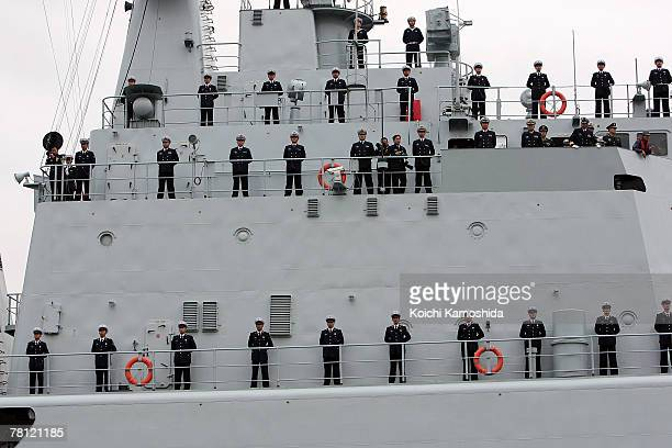 Officers stand as the Chinese naval missile destroyer Shenzhen arrives at Harumi pier November 28 2007 in Tokyo Japan The Japanese Maritime...