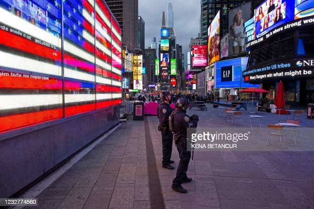 Officers stand guard after two women and a four-year-old girl were injuring by gun fire in Times Square, New York on May 8, 2021. - A shooting in New...