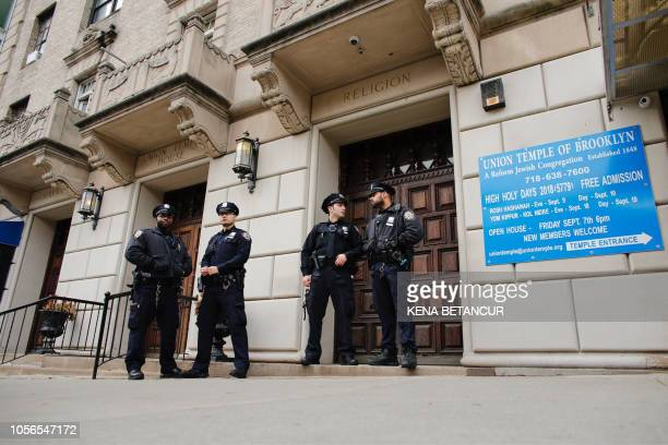 Officers stand guard at the door of the Union Temple of Brooklyn on November 2, 2018 in New York City. - New York police were investigating...