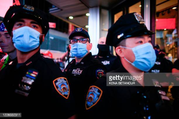 Officers stand guard during a protest to demand justice for Daniel Prude, on September 3, 2020 in New York City. - Protests were planned in New York...