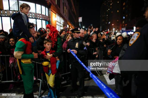 NYPD officers stand guard during the annual Halloween parade after a man driving a rental truck struck and killed eight people on a jogging and bike...