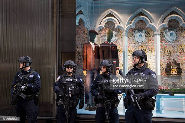 NYPD officers stand guard in front of a Gucci store display near the front door of Presidentelect Donald Trump's Trump Tower in New York NY on...