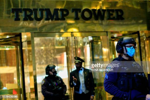 Officers stand guard in front on Trump Tower on 5th Avenue the night before the Presidential Elections in New York, November 2, 2020.