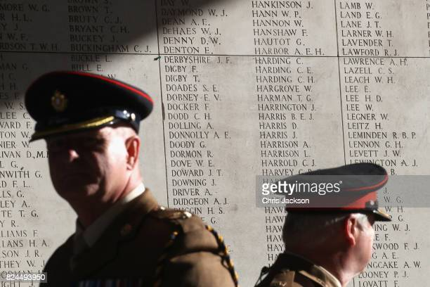 Officers stand in front of the names of 50,000 lost soldiers which are engraved inside the Menin Gate at the Commonwealth War Graves Commission Ypres...