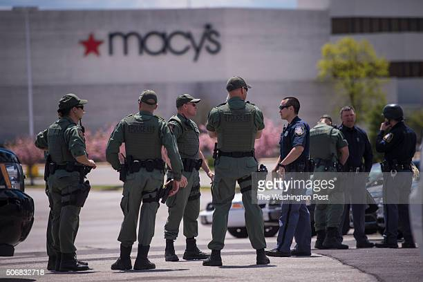 Officers stand infant of the closed Security Square shopping center with rumors circulating that protestors could be on their way as people protest...