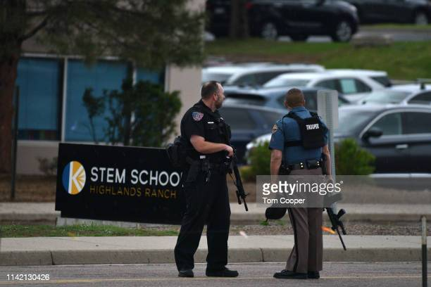 Officers stand watch at the scene of a shooting in which at least seven students were injured at the STEM School Highlands Ranch on May 7 2019 in...