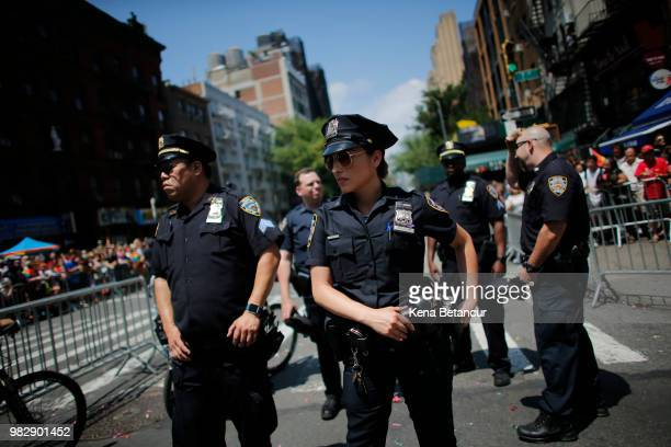 NYPD officers stand watch on Seventh Avenue during the annual Pride Parade on June 24 2018 in New York City The first gay pride parade in the US was...