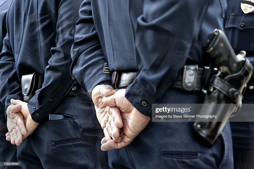 Officers standing with hands behind : Stock Photo