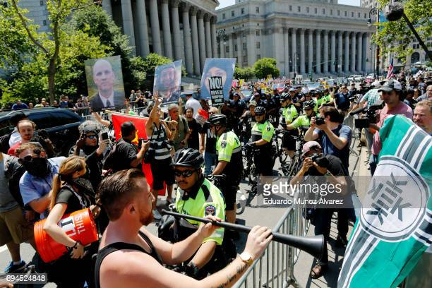 NYPD officers try to separate counterprotesters and activists rallying for the March Against Sharia on June 10 2017 in New York City Marches...