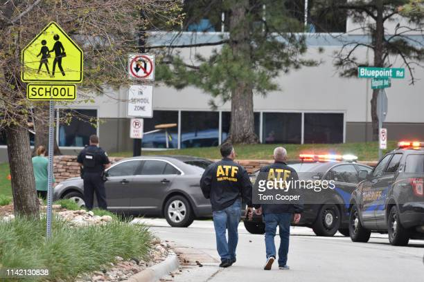 ATF officers walk arrive on the scene of a shooting in which at least seven students were injured at the STEM School Highlands Ranch on May 7 2019 in...