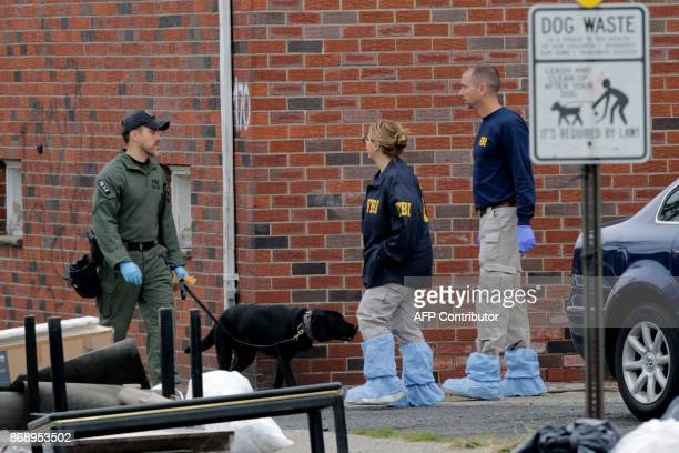 FBI officers walk outside of suspect Sayfullo Saipovs apartment on November 1 in Paterson New Jersey A pickup driver killed eight people in New York...