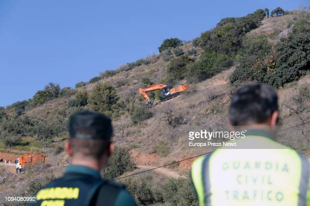 Officers watch during the operation to rescue a twoyearold boy that fell on Sunday into a narrow well 400 feet deep on January 14 in Málaga Spain