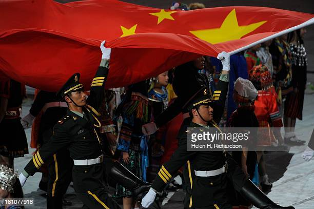 Officers with the Chinese Military bring in the Chinese flag to raise it during the opening ceremonies The opening ceremony for the 29th Olympics was...