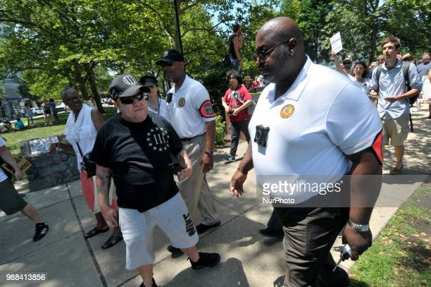 Officers with the Philadelphia Police Dept Civil Affairs unit remove an unnamed individual from the crowd as thousands participate in a rally to...