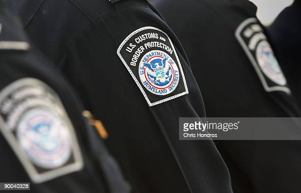 Officers with the US Customs and Border Protection line up in the International Arrivals terminal of Newark International Airport August 24 2009 in...