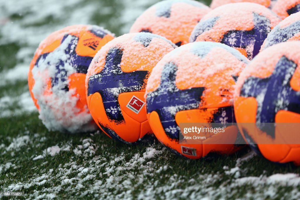Official adidas matchballs Torfabrik are seen on the snow covered pitch prior to the Second Bundesliga match between SV Darmstadt 98 and SSV Jahn Regensburg at Merck-Stadion am Boellenfalltor on December 3, 2017 in Darmstadt, Germany.