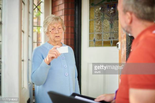 official at the door - con man stock pictures, royalty-free photos & images