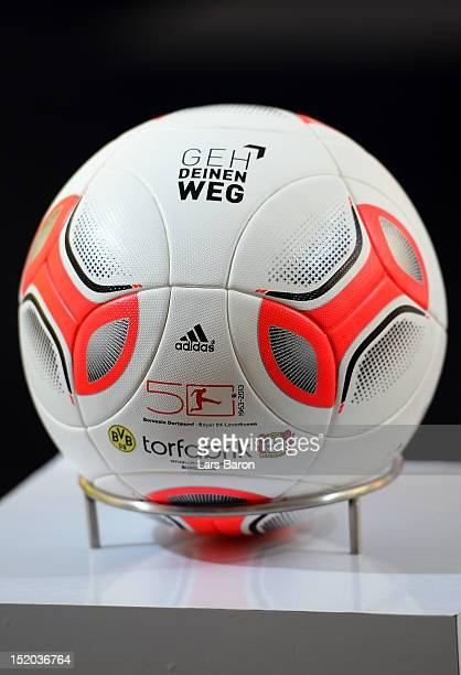A official ball with the 'Geh Deinen Weg' logo is seen prior to the Bundesliga match between Borussia Dortmund and Bayer 04 Leverkusen at Signal...