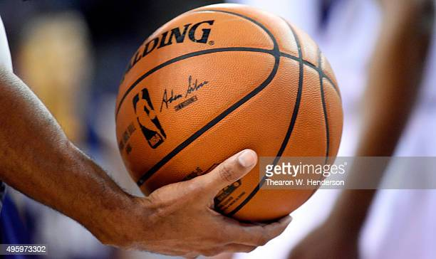 Official Bill Kennedy holds onto the Spalding basketball during an NBA game between the Memphis Grizzlies and Sacramento Kings at Sleep Train Arena...